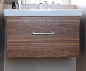 Bespoke walnut dressing room furniture